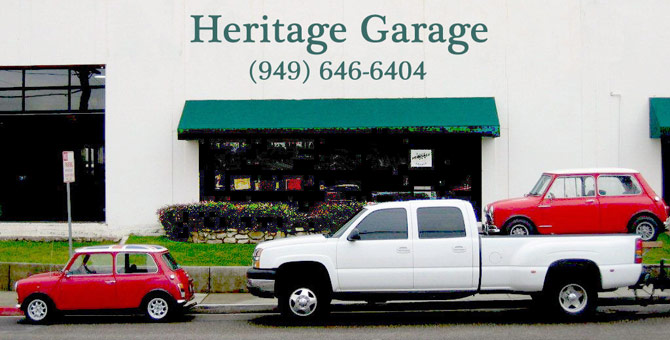 Heritage Garage Exterior with Red Mini on a Pick-up Truck